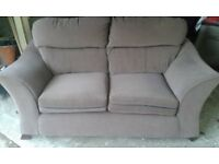 Two Seater Light Chocolate Brown Sofa, as New condition, no marks or stains.