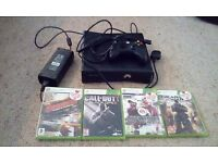 Xbox 360 S 250GB + four games