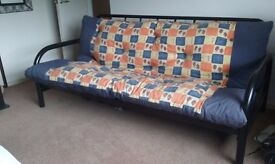 Futon sofa-bed for sale. Folds flat. Ideal as sofa and/or spare bed.