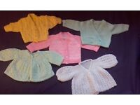 Baby's hand knitted cardigans