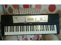 Yamaha keyboard model number E203 with stand