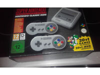 i have for sale brand new super nintendo mini classic with another 421 games installed