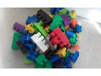Carrier bag of mega blocks - 80ish pieces assorted sizes