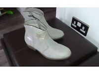 Stylish Boots Size 4 BNWT Pale grey with gold and silver stars on one side of each boot. Low heel.