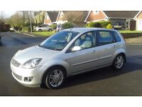 Ford Fiesta Ghia, four door hatchback. Silver with leather trim.