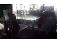 Glass table was 300 pound brand new realy heavy glass four leather chairs with