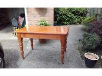 cottage table on castors and has a small draw 29 inches wide - 49 inches long - 31 inches height