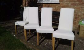 As new 4 white leather dining chairs