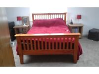 Double wooden framed bed
