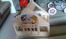 Fabulous solid wood dolls house with wooden furnature and wooden /fabric dolls