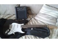 ELECTRIC GUITAR WITH AMP NICE CONDITION.