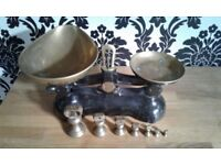 Vintage black weighing scales with brass weights
