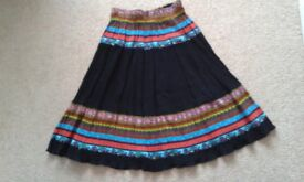 Black multi-coloured skirt with elastic waist. Suit age 9 - 11 years. Excellent condition. £2.50
