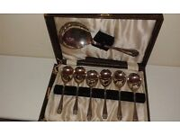 A set of 6 Art Deco ( 1920's) hall marked silver plated soup/dessert spoons with serving spon