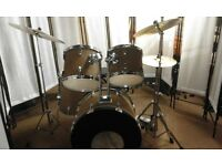 Retired drum teacher has a student drum kit with upgraded cymbals for sale.