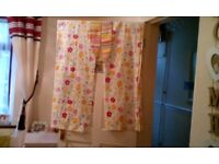 Pretty yellow / white flowery curtains