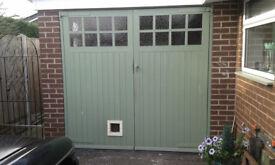 7x7 wooden garage doors 18 months old