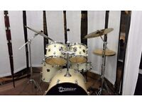 Retired drum teacher has a Premier Cabria/APK drum kit in white marine pearl for sale.