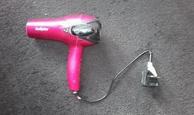 Hairdryer with pull in out action cord