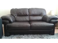 Brown leather two-seater sofa good condition and very comfortable.