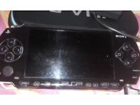 Psp with charger & case ten games three films