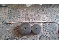Gym weights (32 kg) with with barbell.