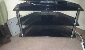 tv cabinet black glass with crome legs in mint condition