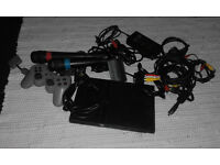 Slim Playstation 2 Singstar Bundle (2 mics, 1 control, and 7 games)