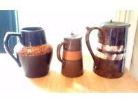 Set of 3 brown Vintage jugs - 2 with pewter lids