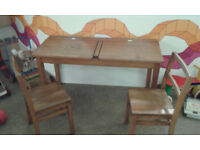 Vintage old school desk and 2 chairs. Has ceramic ink wells.