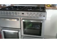 Double electric oven (x1 = fan oven, x1 = electric oven) with 8 gas ring top and storage compartment