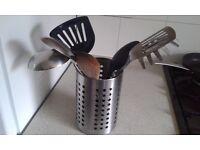 Kitchen vase with a set of utensils