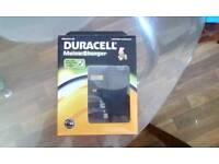 Duracell mains charger. Micro usb and mini usb. Brand new unopened.