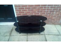 Black glass TV stand few scratches but other than that good condition
