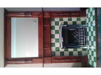 Mahogany fire place with gas fire and large mirror