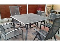 Square grey garden table 4 chairs with matching 2 reclining chairs lovely condition