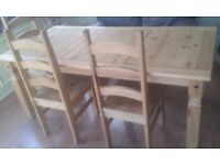 Wooden dining table with three chairs