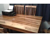 Morrocan oak dining table and 6 chairs. RRP over £1000