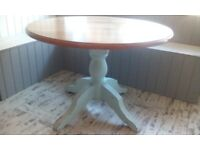 2 round pine dining tables