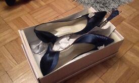 Doris and Daisy Navy heels and handbag