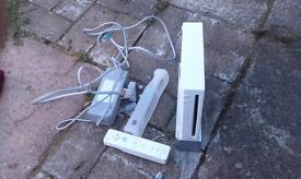 Nintendo Wii, power lead 1 controller and stand, no AV lead or sensor bar