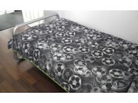 Single bed, mattress and bedding