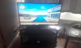 BLAUPUNKT 40 Inch FREEVIEW HD Tv AND Black Glass 3 Tier TV Stand . VERY LOCAL Delivery Possible .