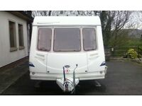 Sterling 490.,fixed bed , motor movers, full awning, CRIS reg etc