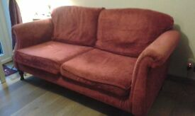Burgundy sofa and different chair