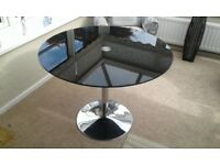 BLACK GLASS AND CHROME ROUND DINING TABLE