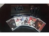 PS3 SUPER SLIM & 5 GAMES