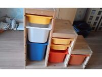 IKEA stepped storage unit with various sizes boxes