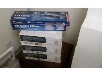 3x unopened boxes of wickes tiles and tile cutter