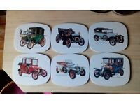 Eight vintage car table mats